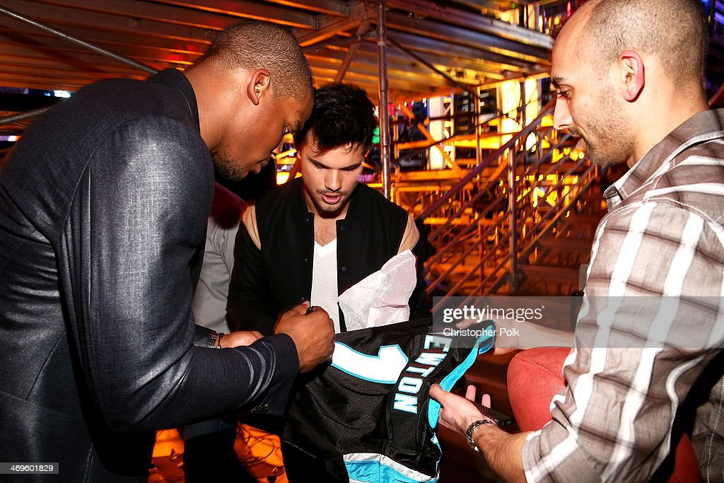 Host Cam Newton (L) and actor Taylor Lautner attend Cartoon Network's fourth annual Hall of Game Awards at Barker Hangar on February 15, 2014 in Santa Monica, California.