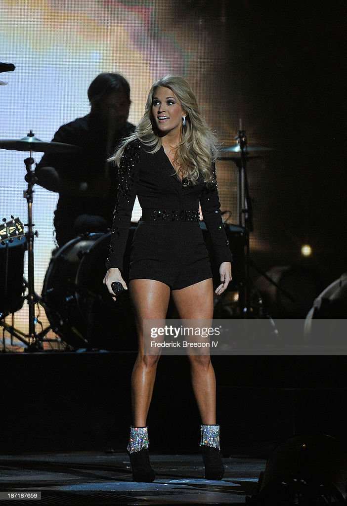 Host Carrie Underwood performs during the 47th annual CMA awards at the Bridgestone Arena on November 6, 2013 in Nashville, Tennessee.