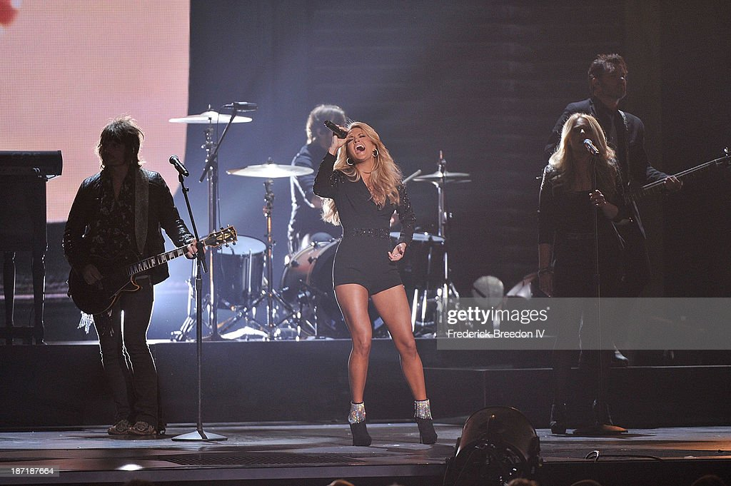 Host <a gi-track='captionPersonalityLinkClicked' href=/galleries/search?phrase=Carrie+Underwood&family=editorial&specificpeople=204483 ng-click='$event.stopPropagation()'>Carrie Underwood</a> performs during the 47th annual CMA awards at the Bridgestone Arena on November 6, 2013 in Nashville, Tennessee.
