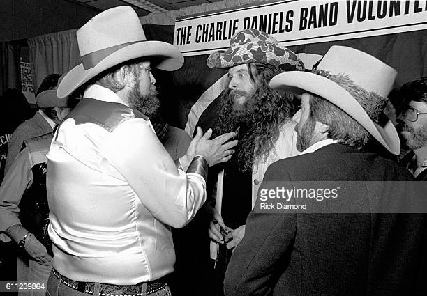 Host Charlie Daniels chats with Ted Nugent and Mickey Gilley backstage during CDB Jam VIII on January 17 1981