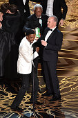 Host Chris Rock actors Morgan Freeman and Michael Keaton celebrate onstage during the 88th Annual Academy Awards at the Dolby Theatre on February 28...