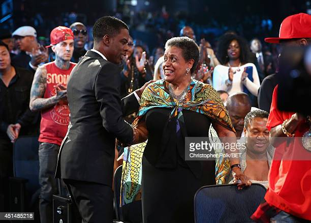 Host Chris Rock and civil rights activist Myrlie EversWilliams attend the BET AWARDS '14 at Nokia Theatre LA LIVE on June 29 2014 in Los Angeles...