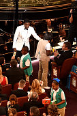 Host Chris Rock and some Girl Scouts sell cookies to audience members during the 88th Annual Academy Awards at the Dolby Theatre on February 28 2016...