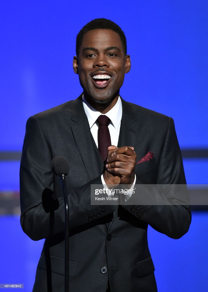 Host Chris Rock speaks onstage during the BET AWARDS '14 at Nokia Theatre LA LIVE on June 29 2014 in Los Angeles California