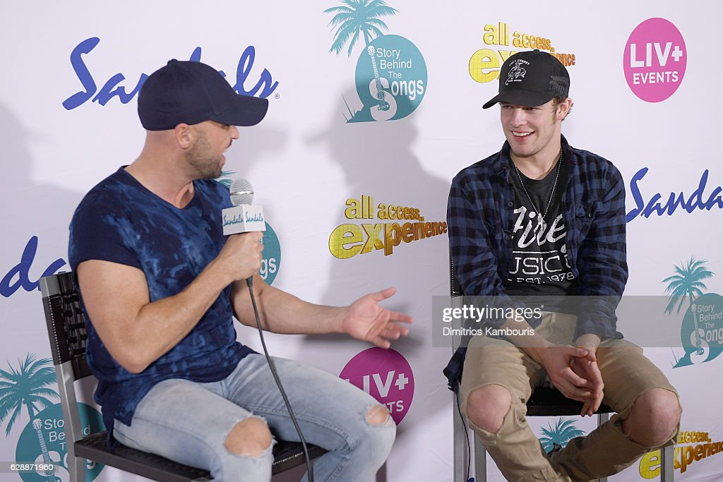 Host Cody Alan (L) interviews recording artist Tucker Beathard during CMT Story Behind The Songs LIV + Weekend at Sandals Royal Bahamian Spa Resort & Offshore Island - Day 2 at Sandals Royal Bahamian on December 9, 2016 in Nassau, Bahamas.