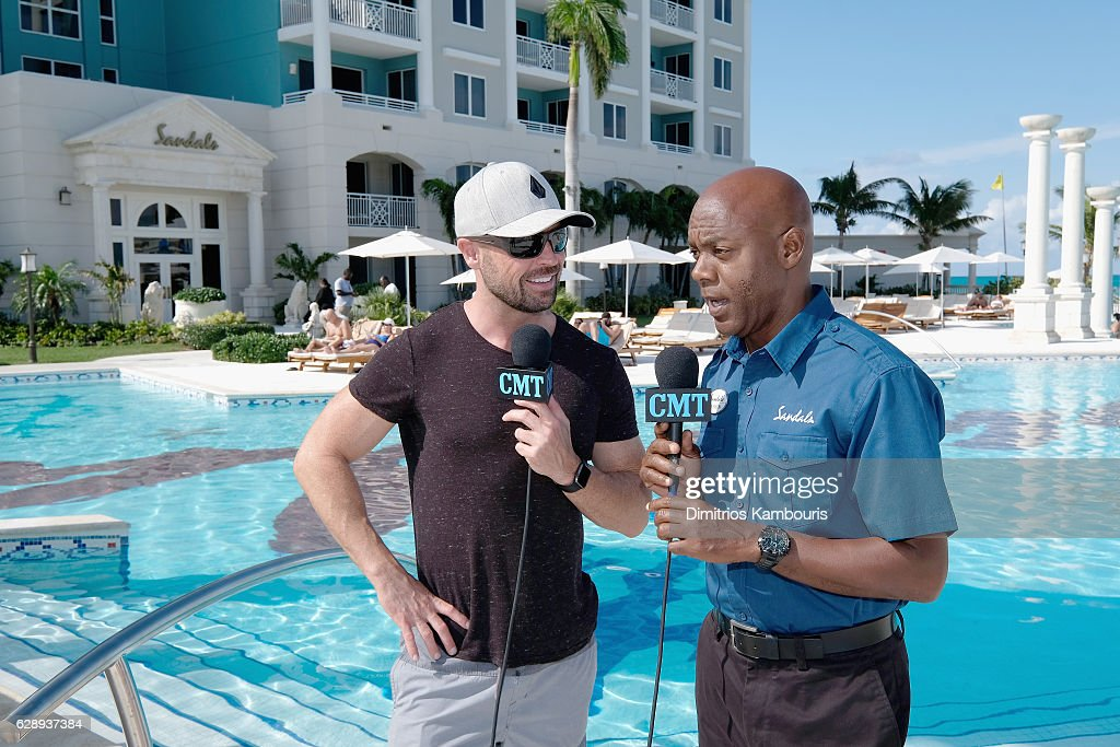 Host Cody Alan (L) is interviewed during a live radio broadcast at CMT Story Behind The Songs LIV + Weekend at Sandals Royal Bahamian Spa Resort & Offshore Island - Day 3 at Sandals Royal Bahamian on December 10, 2016 in Nassau, Bahamas.