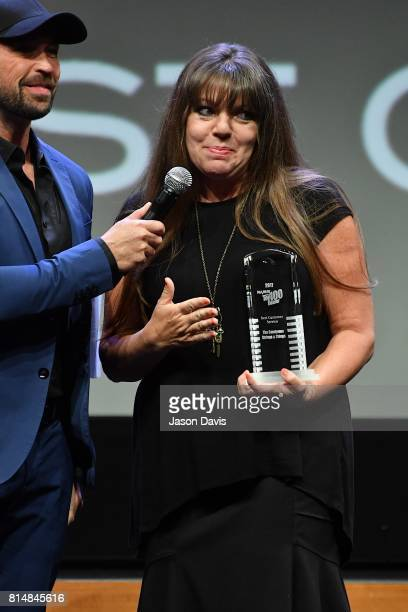 Host Cody Alan presents Cindy Cook of The Candyman Strings and Things the Best Customer Service Award during Top 100 Dealer Awards at Summer NAMM at...