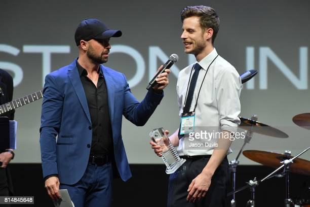 Host Cody Alan presents Lee Voss of Anderton's Music the Best Online Engagement Award during Top 100 Dealer Awards at Summer NAMM at Music City...