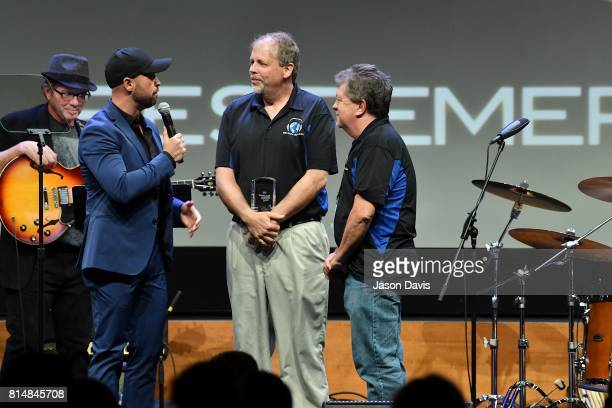Host Cody Alan presents Tony Colwell and Greg Gammon of Third Rock Music the Best Emerging Dealer Award during Top 100 Dealer Awards at Summer NAMM...