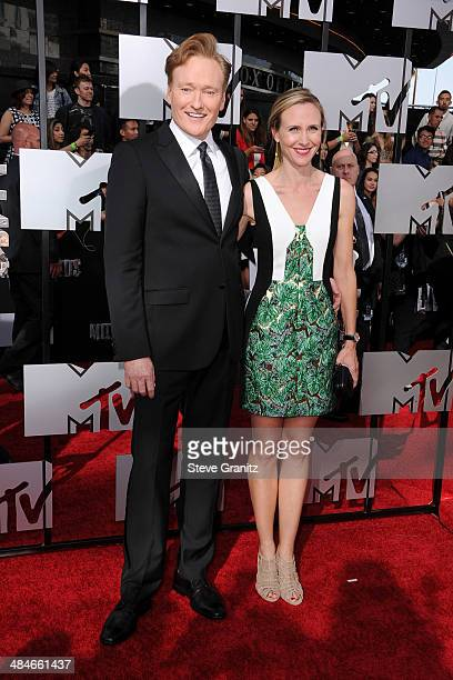 Host Conan O'Brien and Liza Powel O'Brien attend the 2014 MTV Movie Awards at Nokia Theatre LA Live on April 13 2014 in Los Angeles California