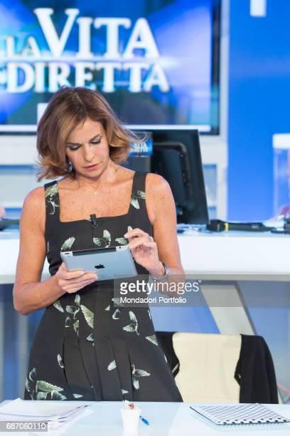 TV host Cristina Parodi using iPad during a break in the studios of the TV program La vita in diretta Rome Italy 4th November 2015