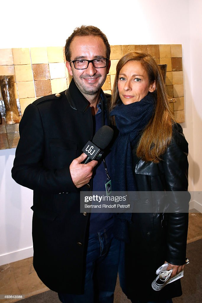 TV Host Cyrille Eldin and Violonist Anne Gravoin the 'FIAC 2015 - International Contemporary Art Fair' at Le Grand Palais on October 21, 2015 in Paris, France.