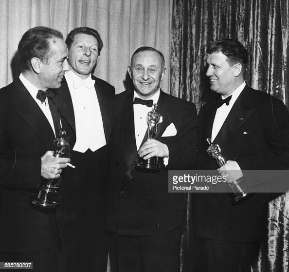 Host Danny Kaye with Oscar winners Humphrey Bogart Arthur Freed and George Stevens at the 24th Academy Awards Los Angeles March 20th 1952