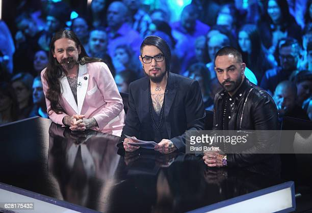 Host Dave Navarro flanked by judges Oliver Peck and Chris Nunez onstage during 'Ink Master' Season 8 Live Finale at at Manhattan Center Grand...