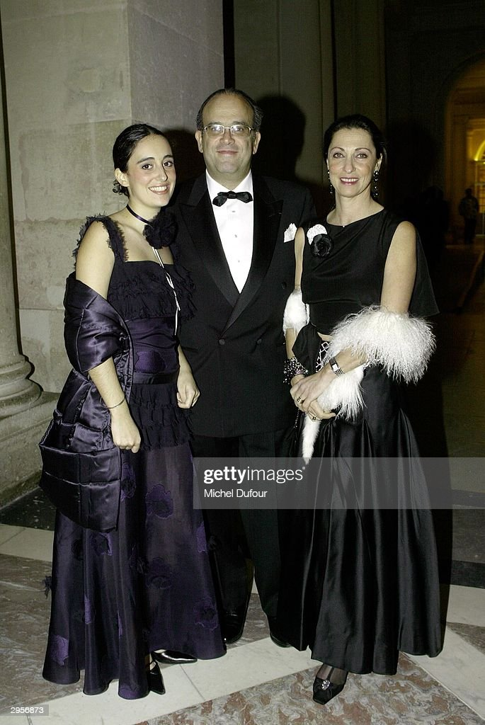 Host David Khayat and his wife and daughter attend the Versailles Charity Gala February 9 2004 in Versailles France