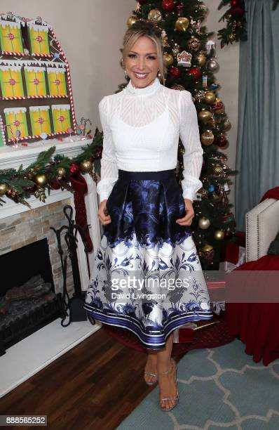 Host Debbie Matenopoulos poses at Hallmark's 'Home Family' at Universal Studios Hollywood on December 8 2017 in Universal City California