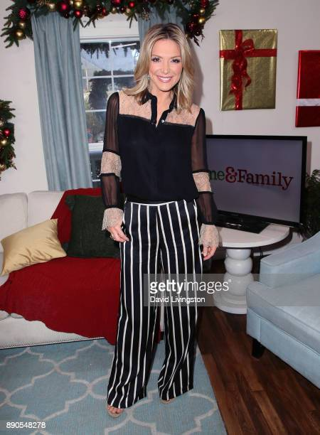 Host Debbie Matenopoulos poses at Hallmark's 'Home Family' at Universal Studios Hollywood on December 11 2017 in Universal City California