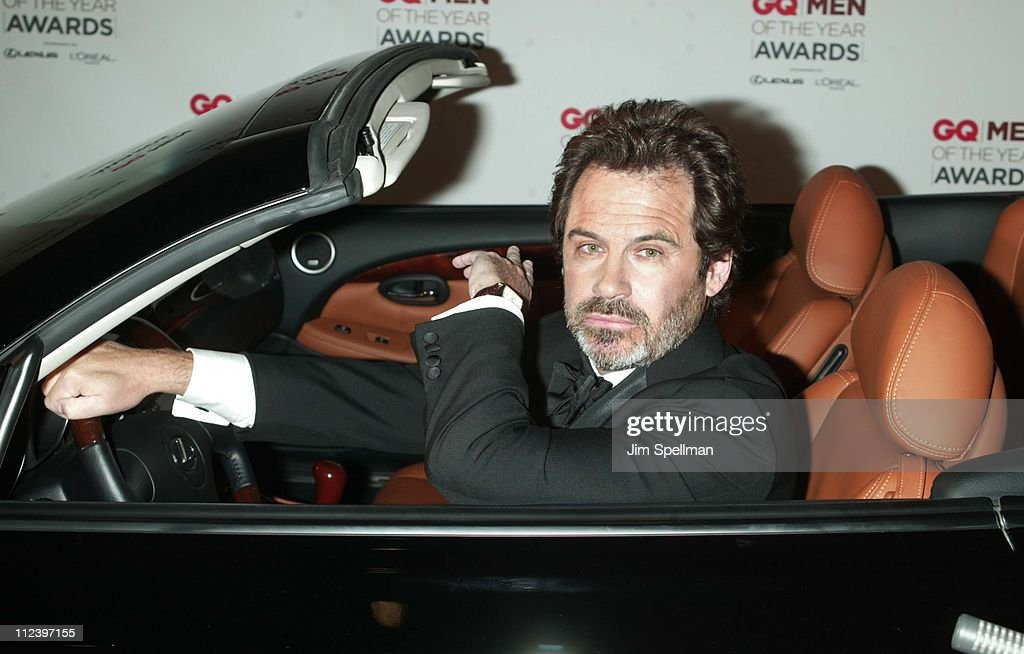 Host Dennis Miller sits in a Lexus for the show's opening