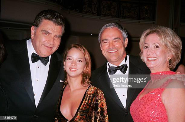 Host Don Francisco poses with actress Adamari Lopez President of Univision Ray Rodriguez and his wife at the Don Francisco gala June 8 2001 in...