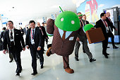 A host dressed up as an Android operating system character greets visitors at the 2014 Mobile World Congress in Barcelona on the second day of the...