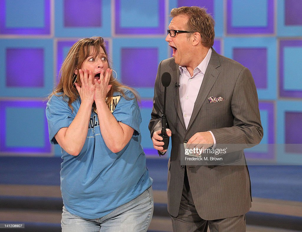 Host <a gi-track='captionPersonalityLinkClicked' href=/galleries/search?phrase=Drew+Carey&family=editorial&specificpeople=213727 ng-click='$event.stopPropagation()'>Drew Carey</a> (R) and a contestant react during CBS' 'The Bold and the Beautiful' Showcase on 'The Price Is Right' television show on March 12, 2012 in Los Angeles, California.