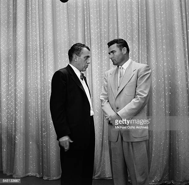 Host Ed Sullivan talks with boxer Jack Dempsey during 'Toast of the Town' show hosted by Ed Sullivan at the Maxine Elliott Theater in New York New...