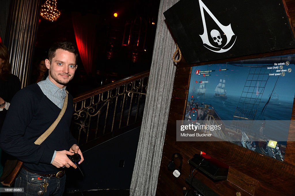 Host Elijah Wood playing the Sony Playstation 4 at the Assasin's Creed IV Black Flag Launch Party at Greystone Manor Supperclub on October 22, 2013 in West Hollywood, California.