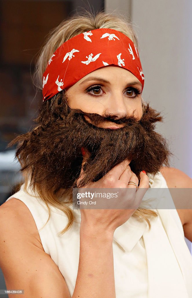 Host <a gi-track='captionPersonalityLinkClicked' href=/galleries/search?phrase=Elisabeth+Hasselbeck&family=editorial&specificpeople=234656 ng-click='$event.stopPropagation()'>Elisabeth Hasselbeck</a> wears a 'Duck Dynasty' costume as 'FOX & Friends' celebrates Halloween at FOX Studios on October 31, 2013 in New York City.