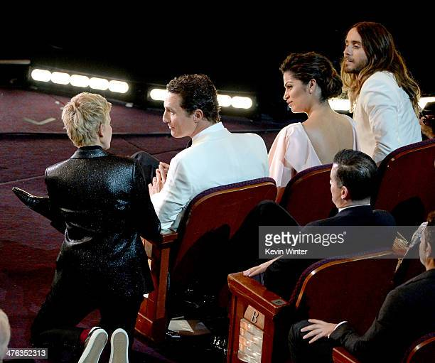 Host Ellen DeGeneres actor Matthew McConaughey Camila Alves McConaughey and actor Jared Leto speak in the audience during the Oscars at the Dolby...