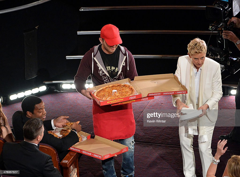 Host <a gi-track='captionPersonalityLinkClicked' href=/galleries/search?phrase=Ellen+DeGeneres&family=editorial&specificpeople=171367 ng-click='$event.stopPropagation()'>Ellen DeGeneres</a> (R) and actor <a gi-track='captionPersonalityLinkClicked' href=/galleries/search?phrase=Chiwetel+Ejiofor&family=editorial&specificpeople=213998 ng-click='$event.stopPropagation()'>Chiwetel Ejiofor</a> (L) with pizza delivery man in the audience during the Oscars at the Dolby Theatre on March 2, 2014 in Hollywood, California.