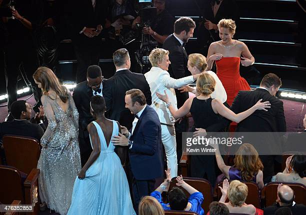Host Ellen DeGeneres in the audience with Lupita Nyong'o Brad Pitt Angelina Jolie Jennifer Lawrence Julia Roberts Meryl Streep Bradley Cooper and...