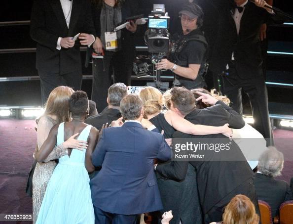 Host Ellen DeGeneres takes the allstar selfie Twitter Pic that broke Twitter with Lupita Nyong'o Brad Pitt Angelina Jolie Jennifer Lawrence Julia...