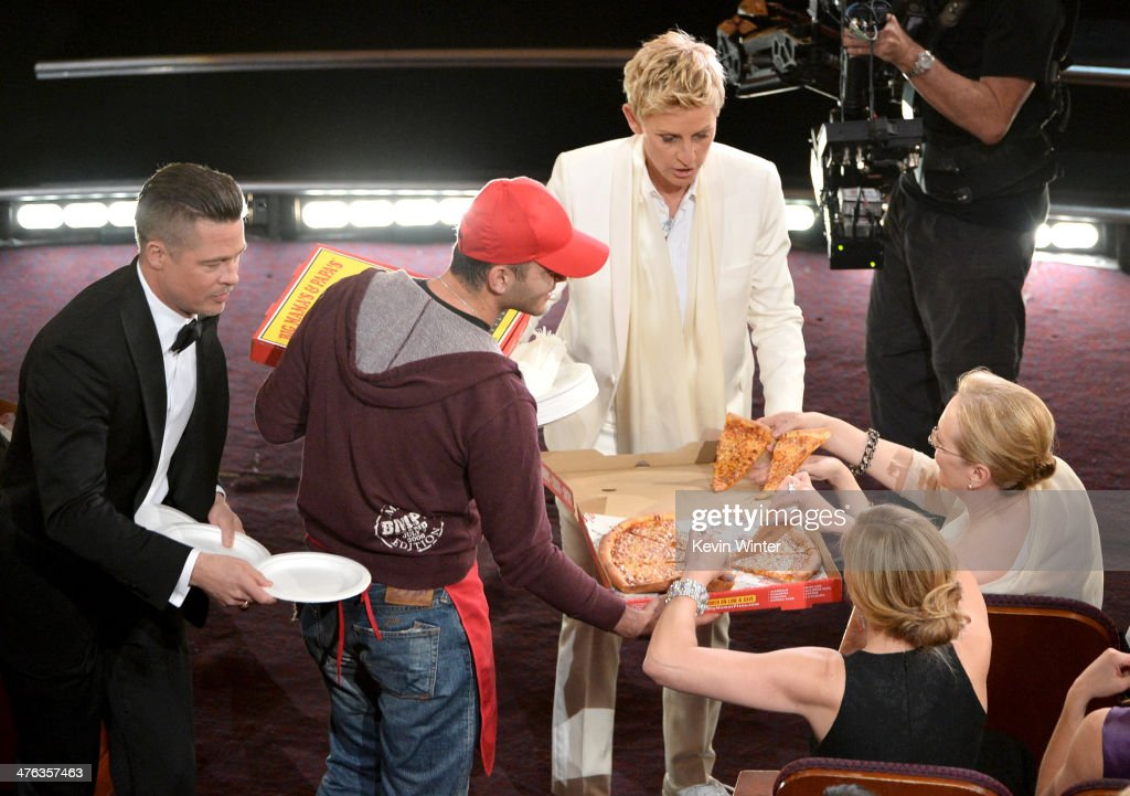 Host Ellen DeGeneres (C) with actor Brad Pitt (L) and actress Meryl Streep in the audience during the Oscars at the Dolby Theatre on March 2, 2014 in Hollywood, California.