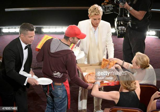 Host Ellen DeGeneres with actor Brad Pitt and actress Meryl Streep in the audience during the Oscars at the Dolby Theatre on March 2 2014 in...