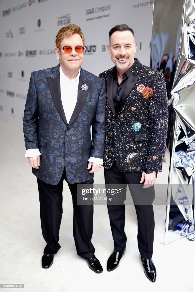 Host Elton John (L) and Chairman David Furnish attend the 25th Annual Elton John AIDS Foundation's Oscar Viewing Party at The City of West Hollywood Park on February 26, 2017 in West Hollywood, California.