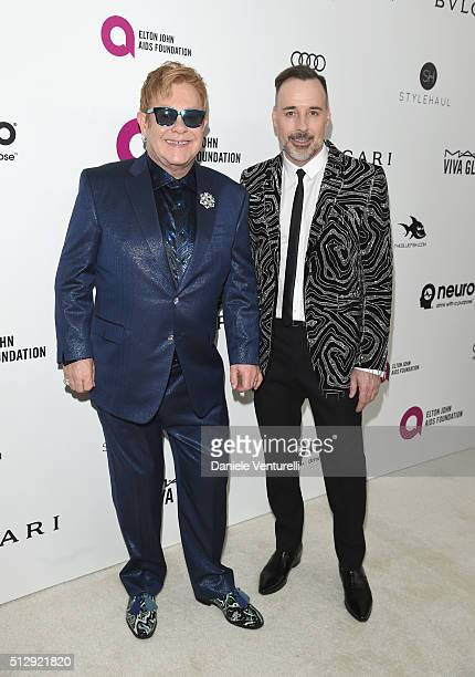 Host Elton John and David Furnish wearing Bulgari attends Bulgari at the 24th Annual Elton John AIDS Foundation's Oscar Viewing Party at The City of...