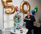 Host Elvis Duran poses with a birthday cake created for him by 'House of Clarendon' as 'The Elvis Duran Z100 Morning Show' celebrate Elvis Duran's...