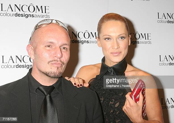 TV host Erika Heynatz and Fashion Designer Alex Perry attend the Lancome Colour Design Awards 2006 at Fox Studios on June 8 2006 in Sydney Australia
