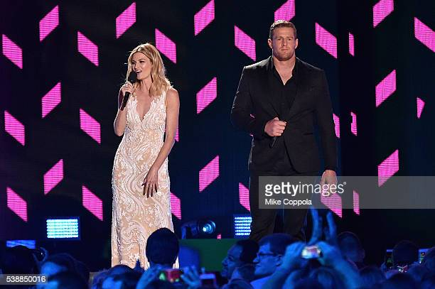 Host Erin Andrews and CoHost JJ Watt onstage during the 2016 CMT Music awards at the Bridgestone Arena on June 8 2016 in Nashville Tennessee