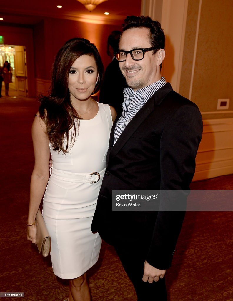 Host <a gi-track='captionPersonalityLinkClicked' href=/galleries/search?phrase=Eva+Longoria&family=editorial&specificpeople=202082 ng-click='$event.stopPropagation()'>Eva Longoria</a> (L) and producer Ben Spector attend the Hollywood Foreign Press Association's 2013 Installation Luncheon at The Beverly Hilton Hotel on August 13, 2013 in Beverly Hills, California.