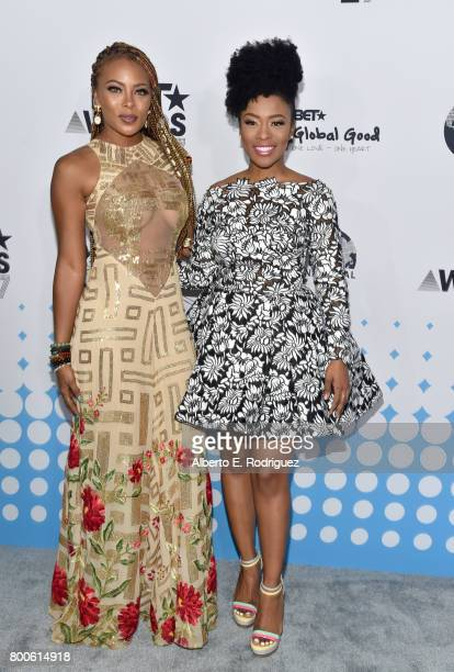 Host Eva Marcille and guest attend the 2017 BET International Awards Presentation at Microsoft Theater on June 24 2017 in Los Angeles California