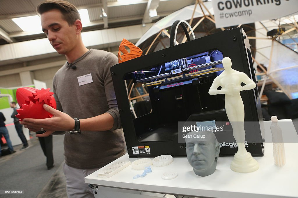 A host explains various objects created from molten plastic and a MakerBot 3D printer at the 2013 CeBIT technology trade fair on March 5, 2013 in Hanover, Germany. CeBIT will be open March 5-9.