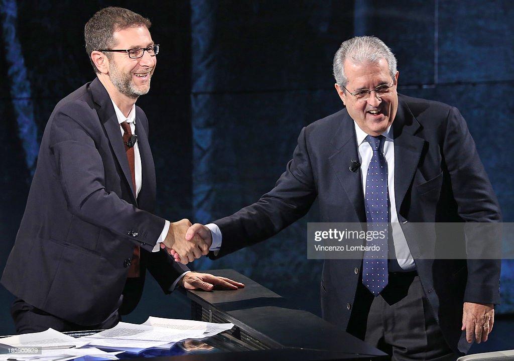 Host <a gi-track='captionPersonalityLinkClicked' href=/galleries/search?phrase=Fabio+Fazio&family=editorial&specificpeople=774725 ng-click='$event.stopPropagation()'>Fabio Fazio</a> shakes hands with Fabrizio Saccomanni on tv show 'Che Tempo Che Fa' on October 26, 2013 in Milan, Italy.