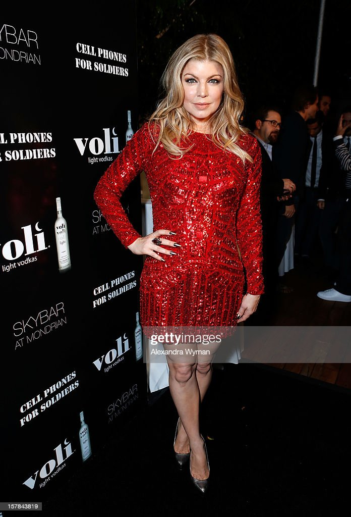 Host Fergie attends Voli Light Vodka's Holiday Party hosted by Fergie Benefiting Cellphones for Soldiers at SkyBar at the Mondrian Los Angeles on December 6, 2012 in West Hollywood, California.