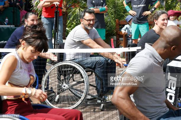 TV host Frederic Lopez and journalist Erika Moulet attend the Race during the 'All in Wheelchair Day' as part ofthe 2017 French Tennis Open Day...