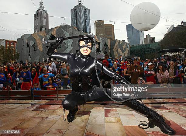 Host Georgia Sinclair poses as Melburnians dressed as superheroes participate in a Guinness World Record attempt for the most number of people...