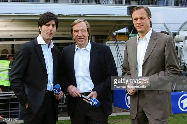 TV host Gerhard Delling headcoach Joachim Loew and Guenther Netzer poses for the media infront of the men's U15 international friendly match between...