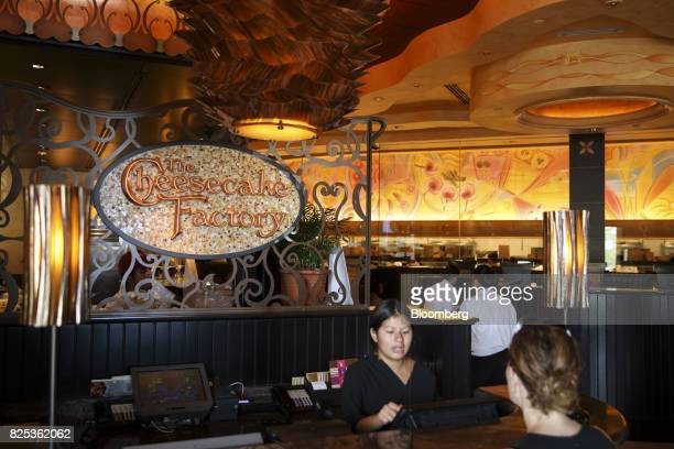 A host greets a diner at a Cheesecake Factory Inc restaurant in the Canoga Park neighborhood of Los Angeles California US on Tuesday Aug 1 2017 The...