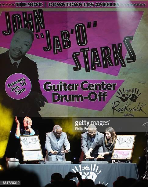 Host Gregg Bissonette Rockwalk inductees Clyde Stubblefield and John 'Jab'o' Starks and Guitar Center's Jamesina Rammelkamp perform the handprint...