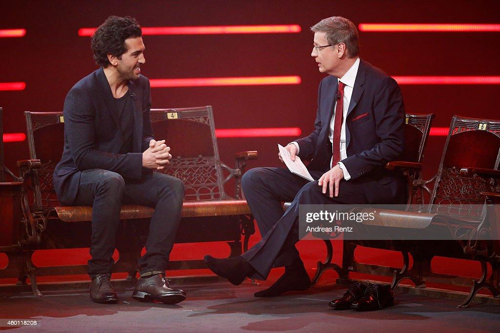 TV host Guenther Jauch (R) interviews without his shoes Elyas M'Barek during the 2014! Menschen, Bilder, Emotionen - RTL Jahresrueckblick show on December 7, 2014 in Cologne, Germany.